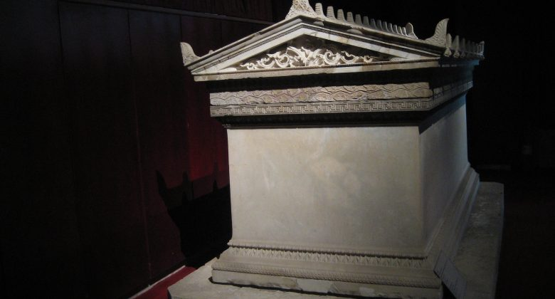 A picture of a white tomb, blank with little ornamentation.